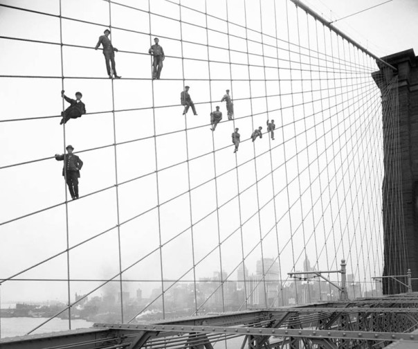 hanging-out-on-brooklyn-bridge-cables-black-and-white-old-vintage 1914  Eugene de Salignac